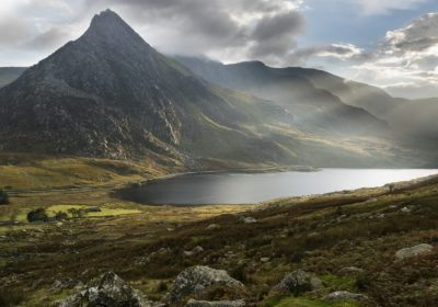 Tryfan and Llyn Ogwen lake in Snowdonia with crepuscular rays